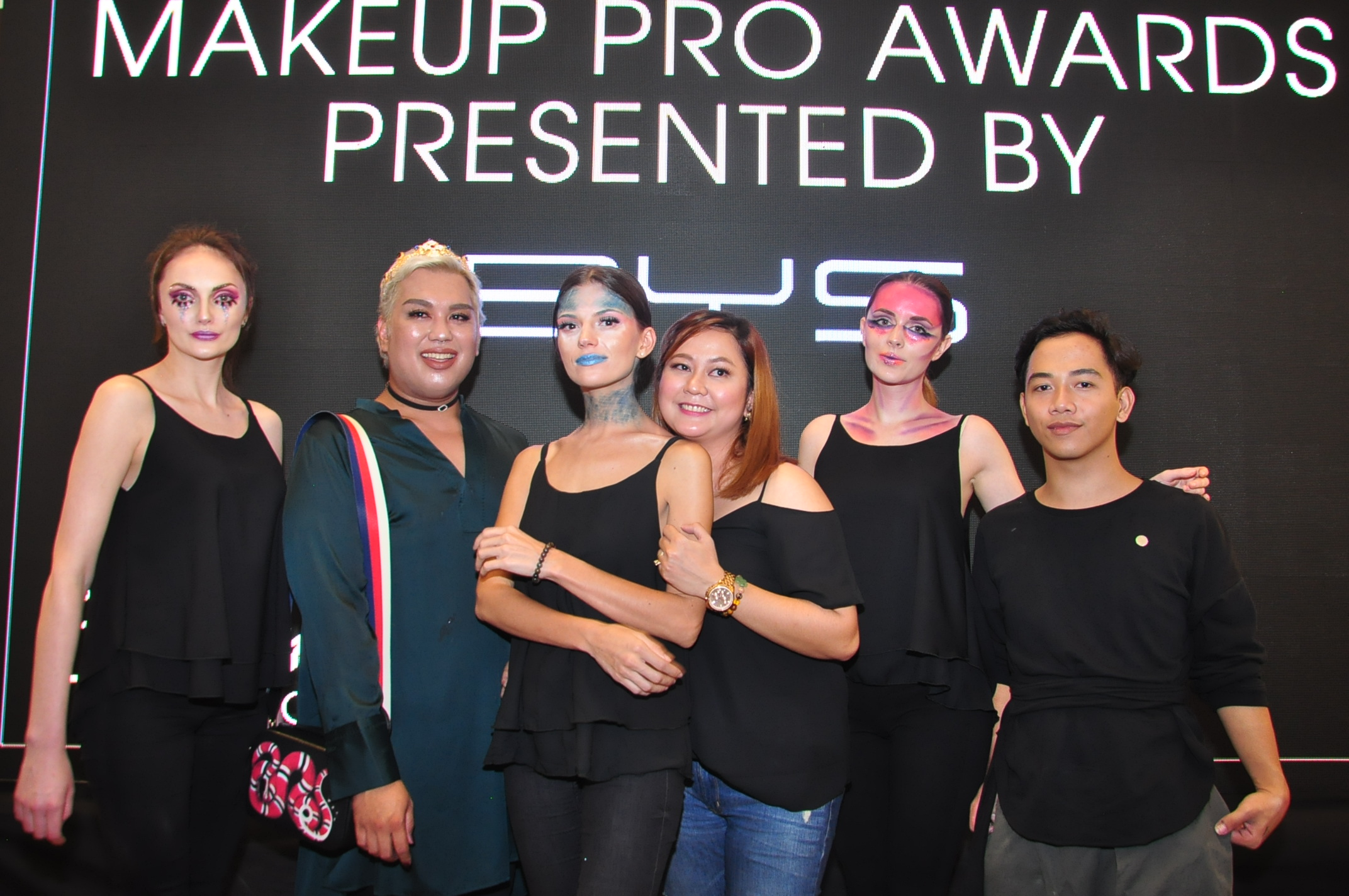 Model Irina Zinchenko with makeup artist Nap Candelaria, Model Alla Alla with makeup artist Muriel Jada Nubla, and Model Sandra Ma with makeup artist Zidjian Floro