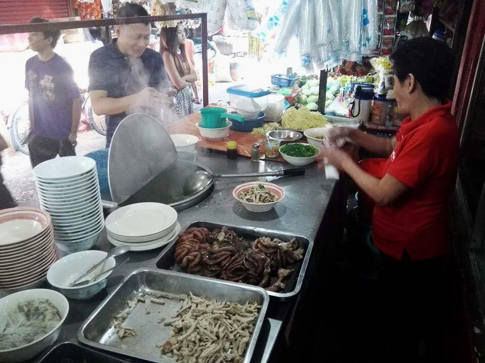 Pots of broth are kept hot outside Netong's at La Paz market. Ingredients are assembled upon order.