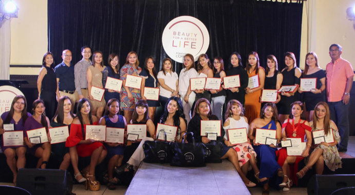 The proud graduating Class of 2019 (Batch 6) from Brgy Jesus Dela Pena who received their TESDA certificates and Beauty For a Better Life program diploma with L'Oreal Philippines Corporate Communications Manager, Carmel Valencia (far left); Tourism Head of Marikina City, Ponchie Santos (second to the left); Philippine Business for Social Progress Director for Operations Elvin Uy (third from left) and Brgy Jesus Dela Peña Captain, Ariel Lazaro (rightmost).