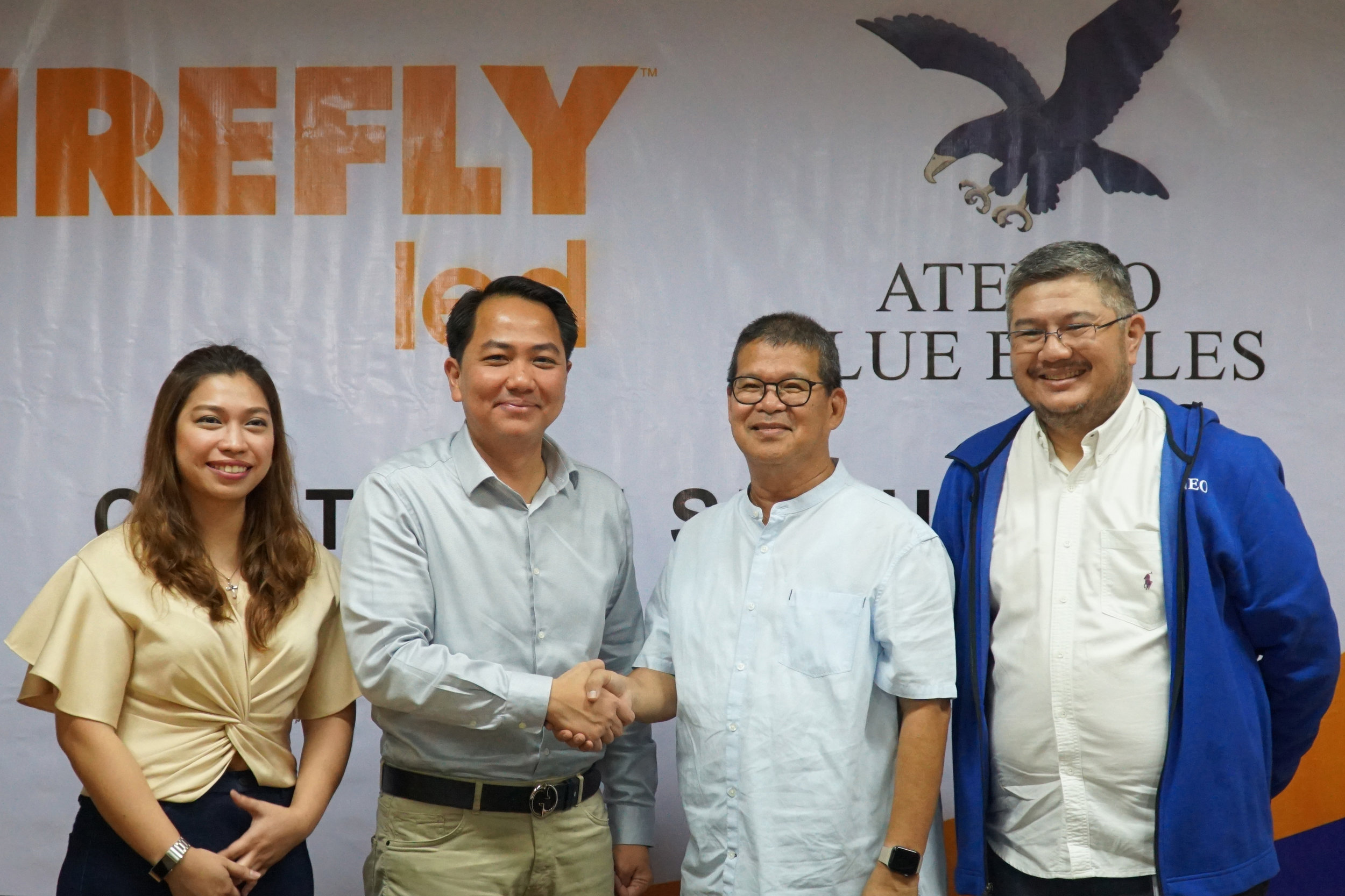 Firefly LED seals the deal with Ateneo's University Athletics' Fr. Nemesio S. Que SJ and Emmanuel T. Fernandez.jpg