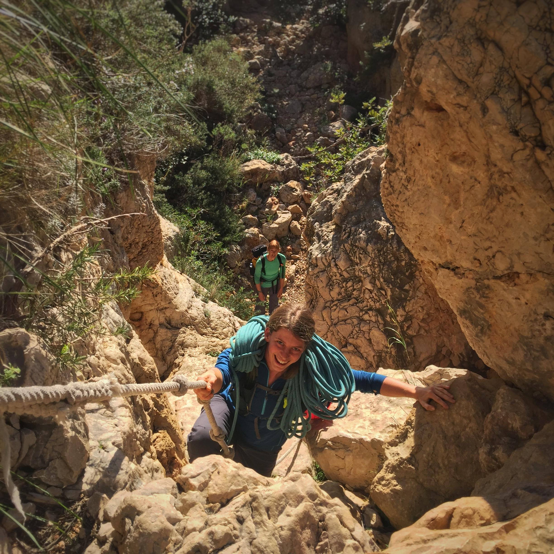 Kate Ayres (top) leading the way through a 'hidden' canyon approach route, Costa Blanca