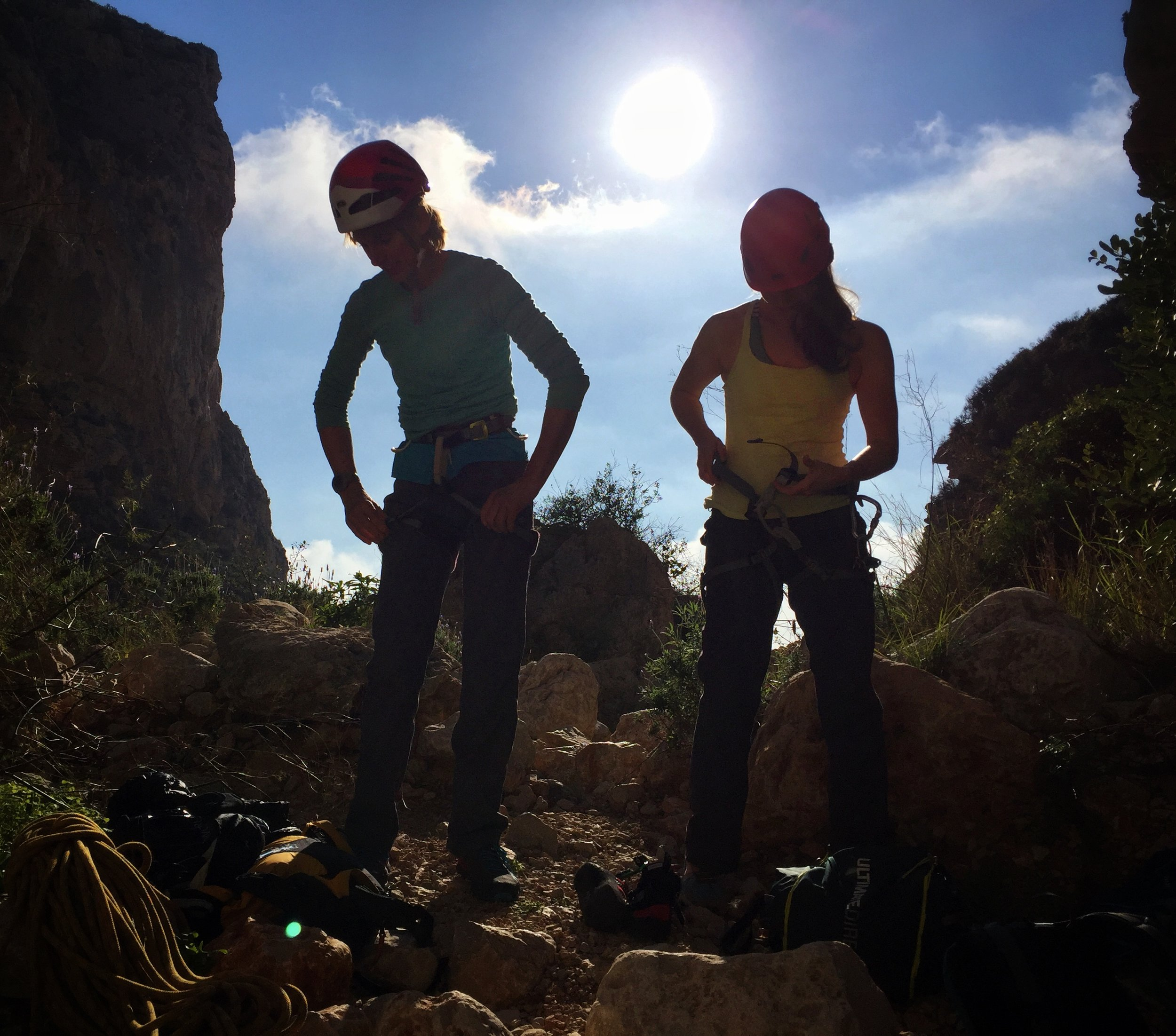 Kate Ayres (left), gearing up for a multipitch sea cliff climb at Morro Falqui, Costa Blanca