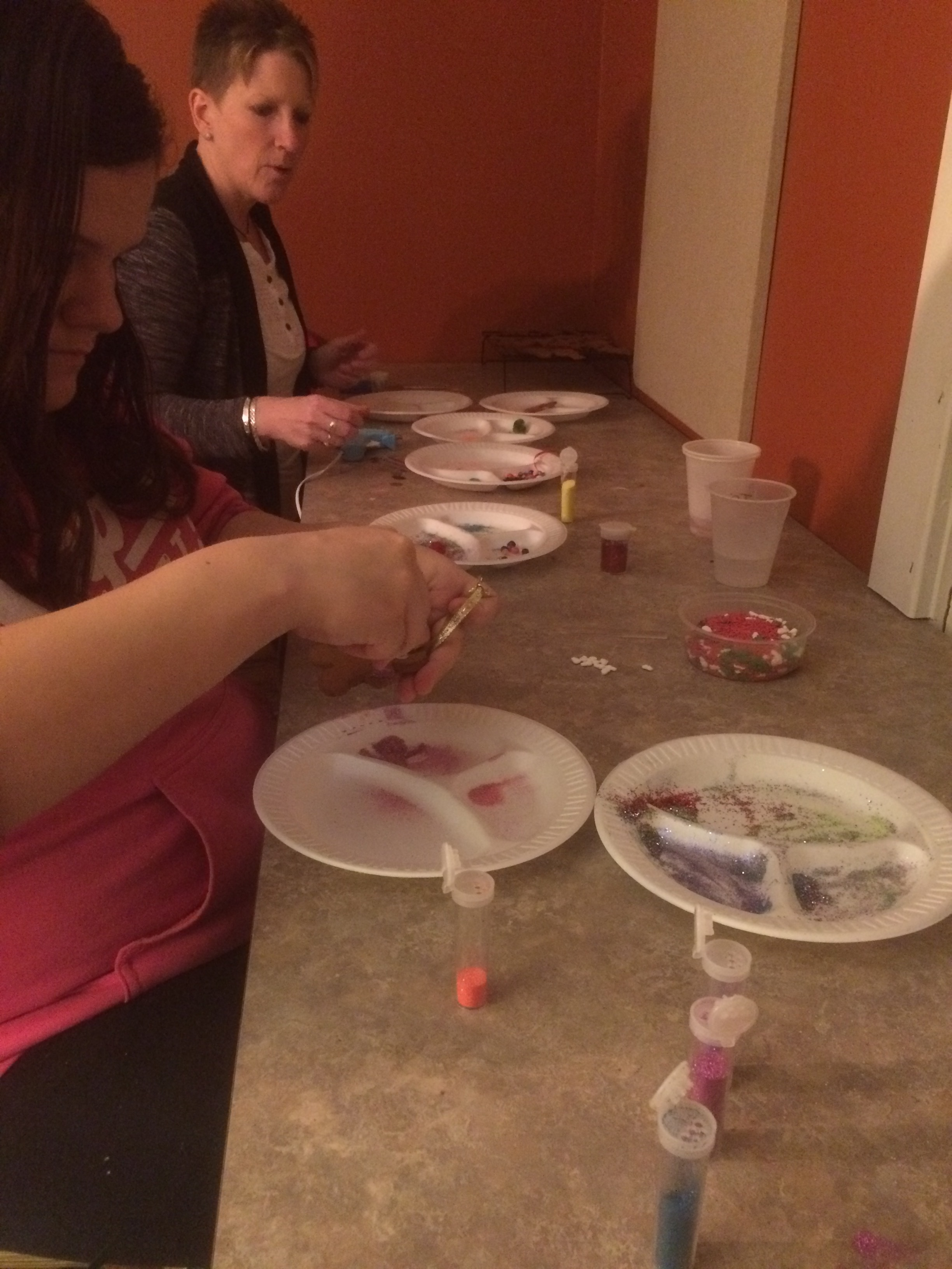 Decorating homemade ornaments.