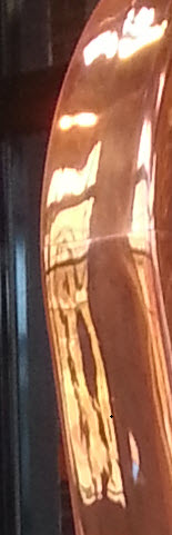 """Still Room windows reflected in the shiny copper """"bottle"""" atop the Spirit Safe. @ Angel's Envy Distillery"""