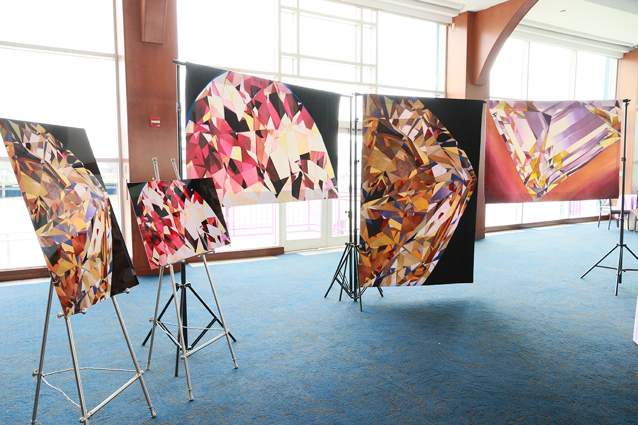 gemstone quilt artwork display at WJA exhibit in New York City