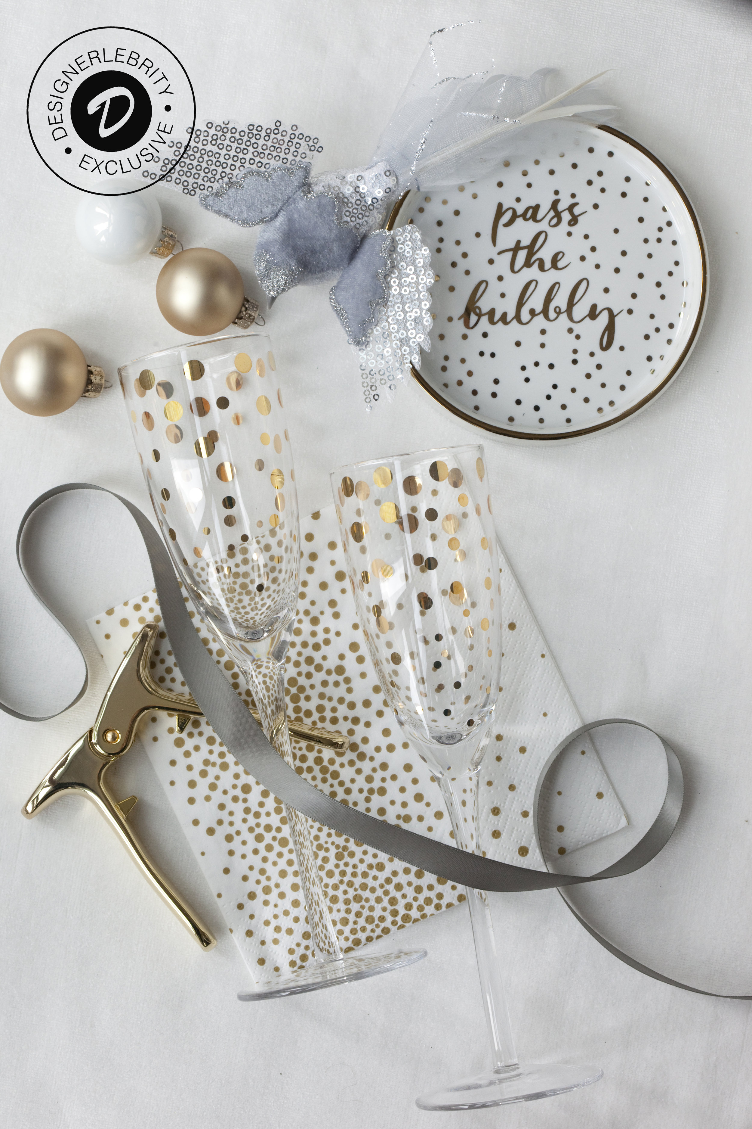 C&V DELUXE BOX INCLUDES: - ~ Two (2) Champagne Flutes by Abbott~ One (1) Champagne Puller by Viski~ One (1) Champagne Tray by Rosanna~ One (1) Package of Confetti Napkins by Abbott~ One (1) Velvet Bird Ornament by Abbott~ One (1) House and Home Magazine Dec IssuePrice: $59 (approximately USD) $74.95 Canadian