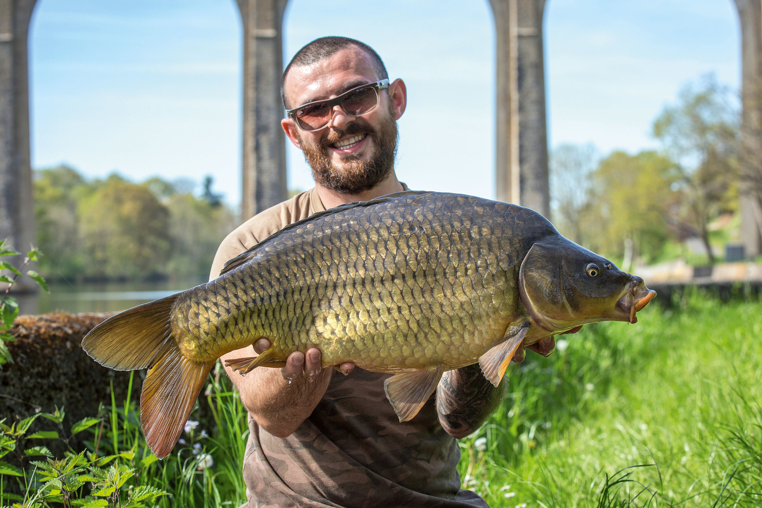 Sean with the first carp from the river, at a little over 21lb