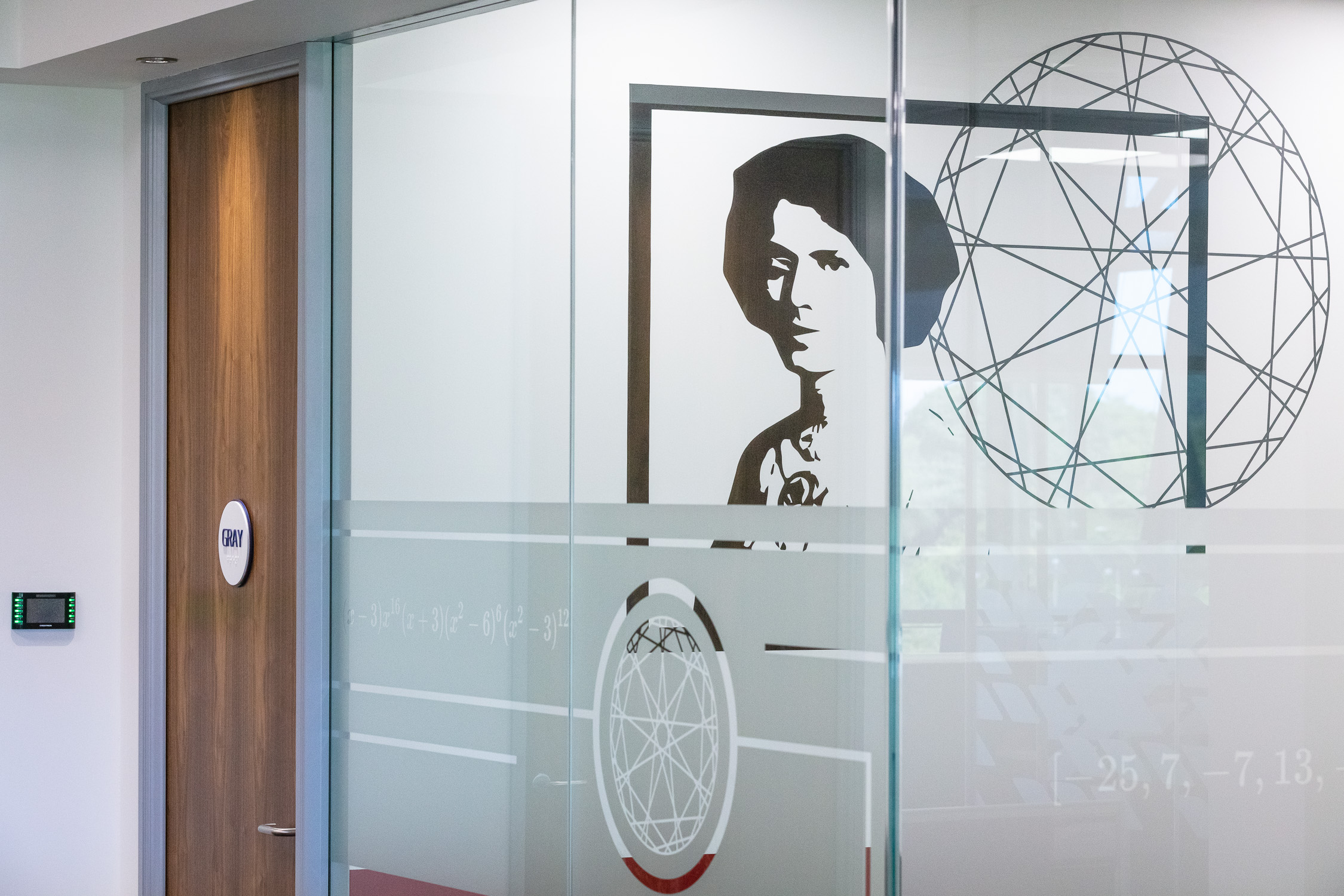 Bespoke glass partitioning and wall graphic design.jpg