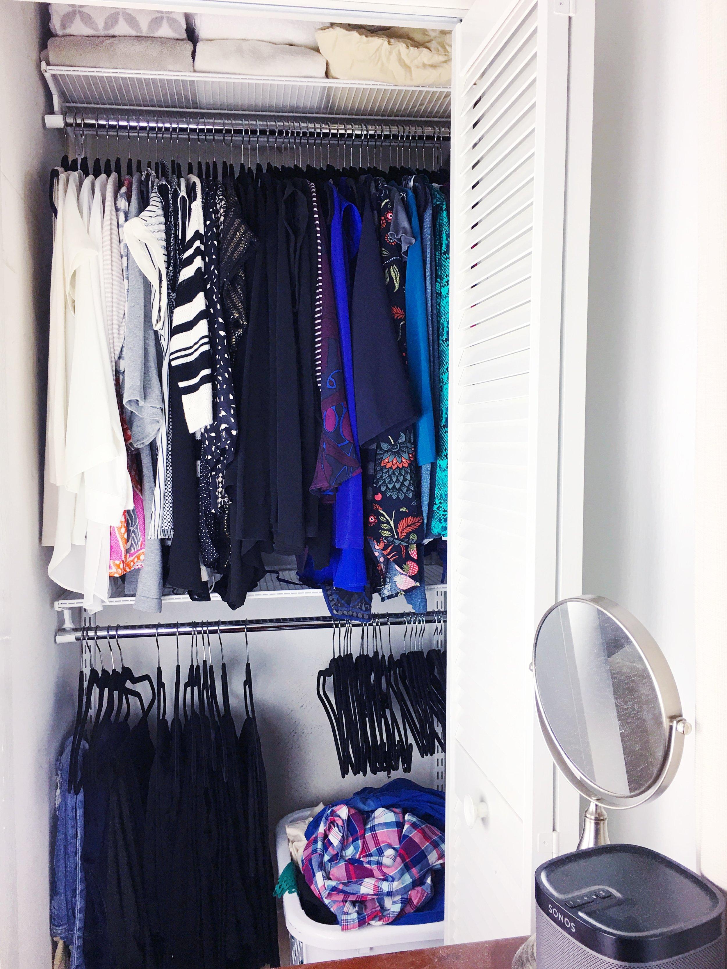 'hers' closet organization after