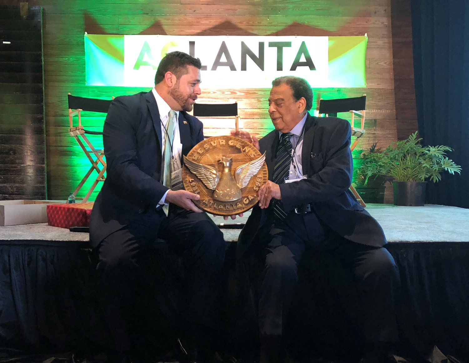 Atlanta's Director of Urban Agriculture, Mario Cambardella (left), presents the Seal of Atlanta to Ambassador Andrew Young (right), to honor his dedication to urban agriculture and resilience.