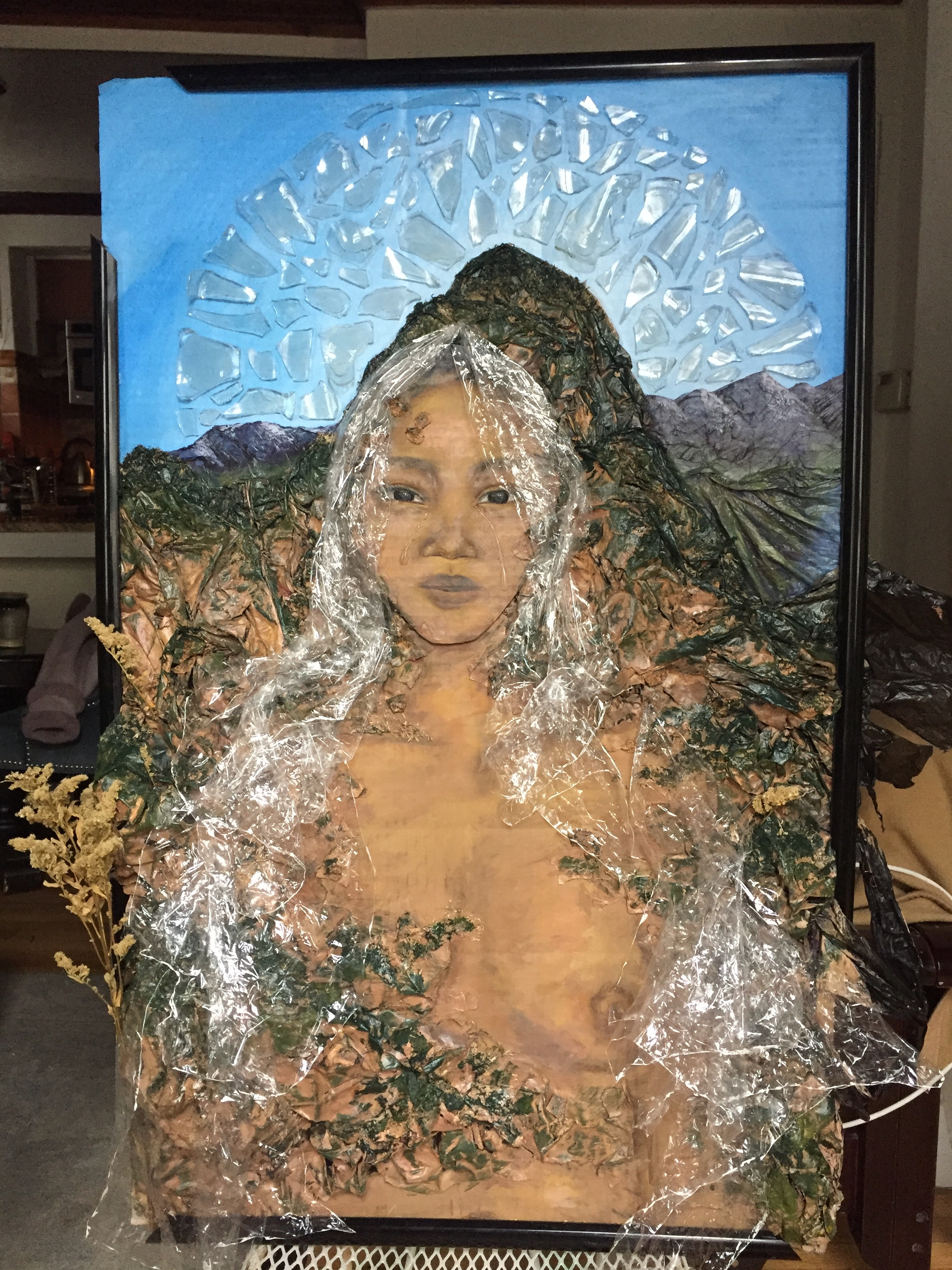 "Atabey - (2019). Cardboard, plastic bags, glass, cork, dried flowers, dirt, chalk pastel, acrylic paint.""Atabey"" means 'Mother Earth' in the language of the Taíno Indians (the indigenous people that inhabited Cuba, Dominican Republic, Haiti, Jamaica, and Puerto Rico). We used recycled materials including paper and plastic bags, cardboard and glass, creating this piece to embody the goddess. This piece was displayed at the Eco-Art Showcase in Brooklyn.Read more about the showcase: https://www.sustainthemag.com/Co-created by Bianca Williams"