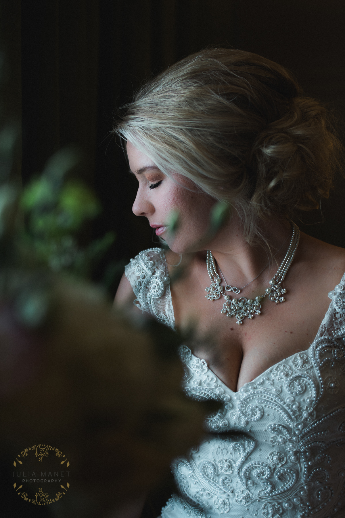 Beautiful bride prepares herself in the window light at the Hilton Garden Inn Yuma.