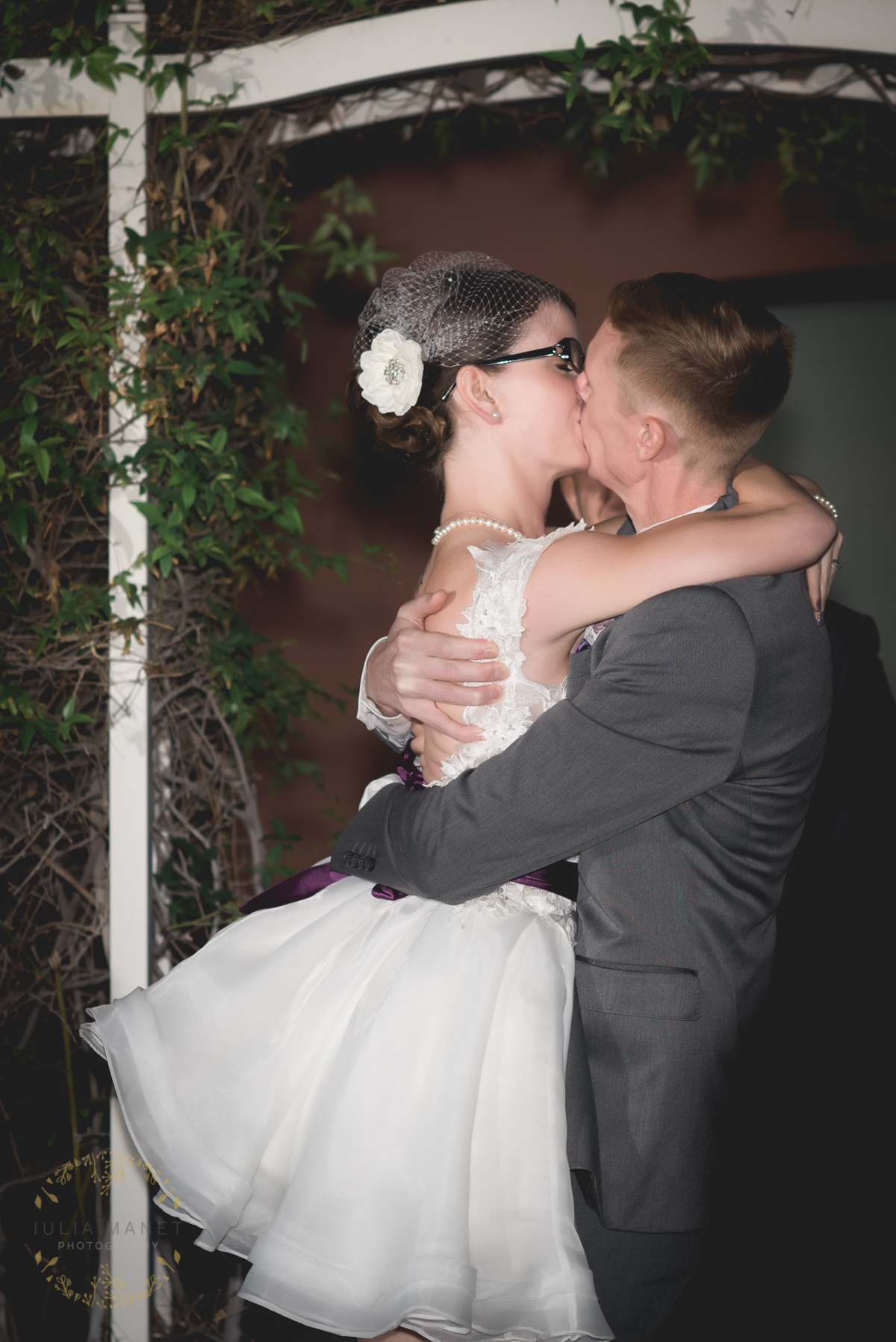 """You may kiss the bride!"" the officiant said. So, they kissed. Then kissed again. He lifts her up off her feet in exuberance. Someone in the crowd jokingly shouts, ""Oh come on, guys. Cut it out!"" And the bride, bless her heart, snaps, ""No!"" and kisses him again."
