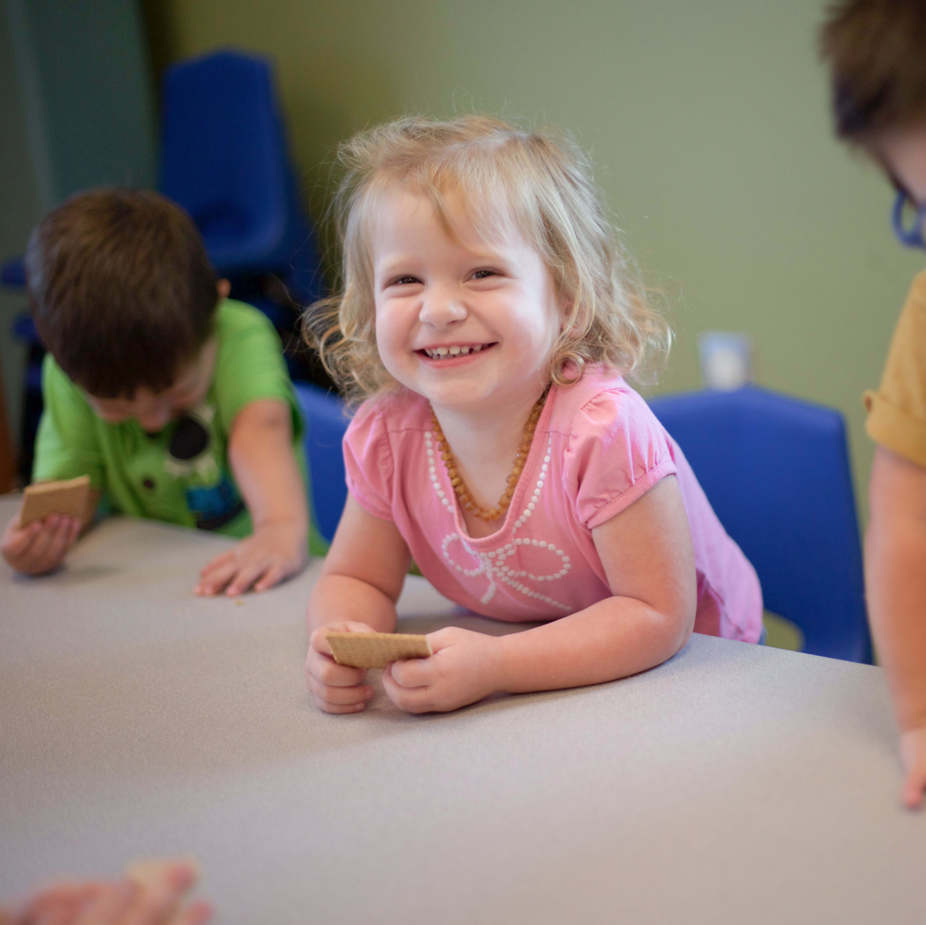 Ones & Twos - Our toddlers are offered a variety of opportunities to explore the world God made through play. Gross motor skills and social skills are developed through both structured and unstructured playtime. Their days are filled with music, art, story time, outside time and more.