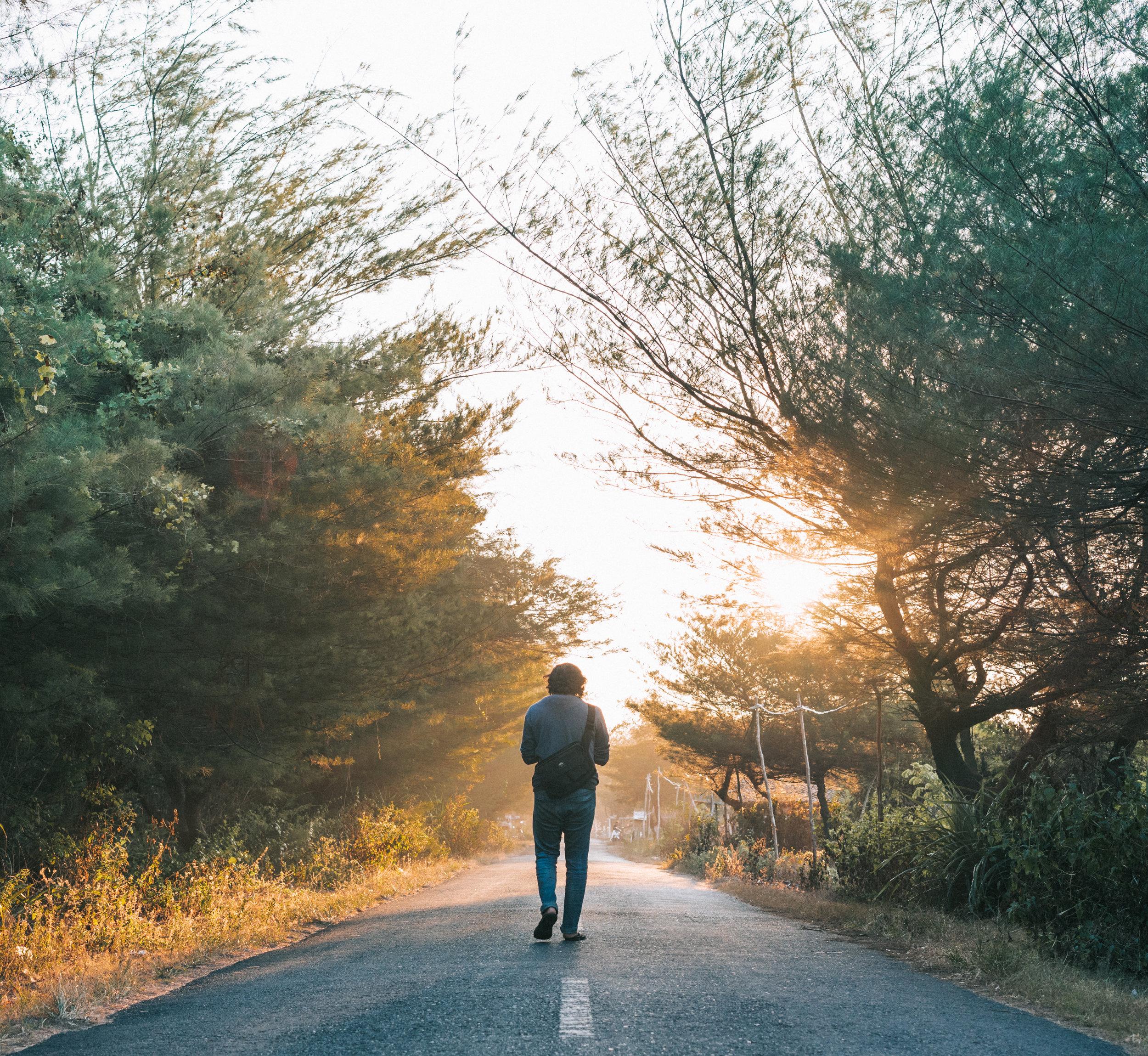 Canva - Man Walking on the Gray Asphalt Road.jpg