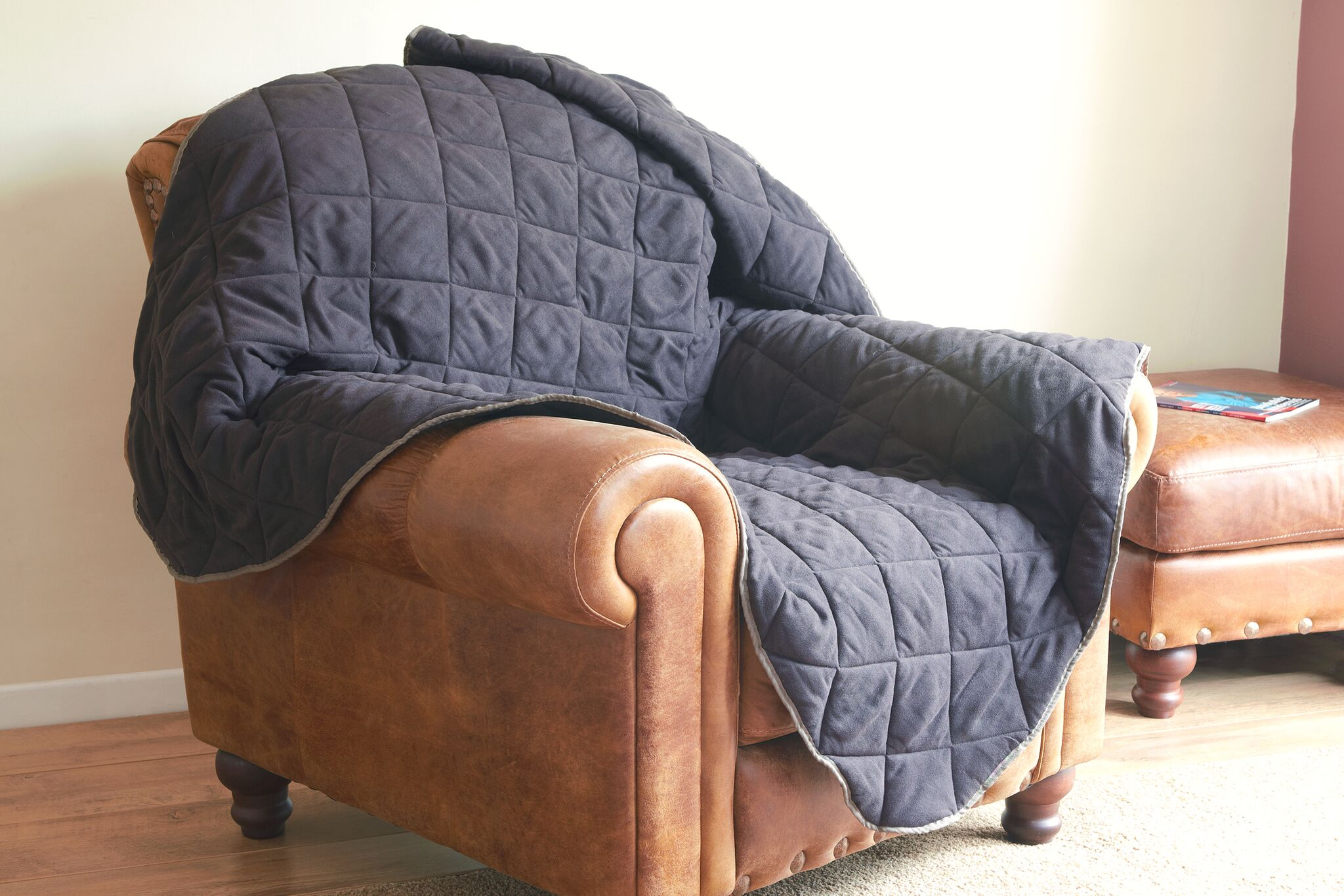 Deluxe throws for your chair or a larger one for your sofa, available at the Raffles Shop.