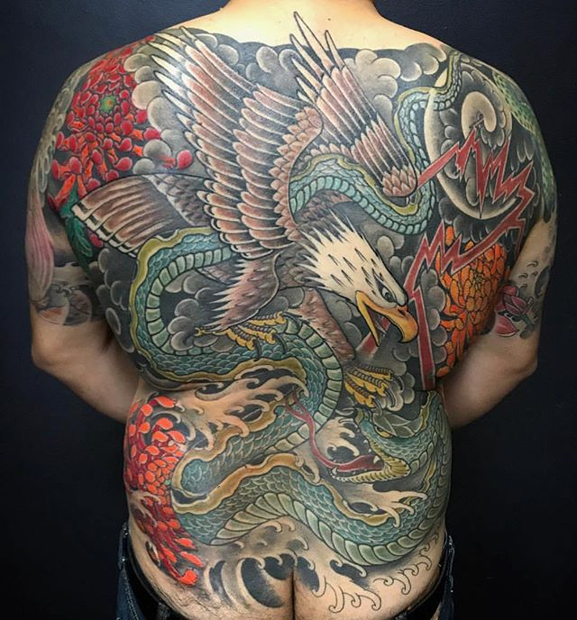 Eagle and snake battle by @robertatkinson_tattoo