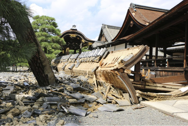 """Caption:  """"This photo shows a collapsed wall on the southern side of the south Noh stage, a Japanese important cultural property, at the UNESCO World Heritage-listed Nishi Honganji Temple in Kyoto, on Sept. 5, 2018. (Kyodo [news organization])."""" From """" Western Japan Businesses Reeling from After-Effects of Typhoon Jebi ,""""  The Mainichi , Sept. 5, 2018. Copyright 2018 The Mainichi Newspapaers Co., all rights reserved. Image and caption used here, permission pending."""