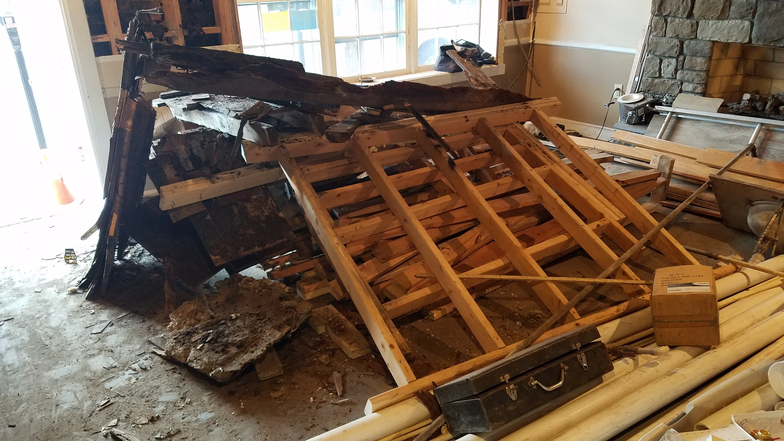 Debris from the old floor truss system