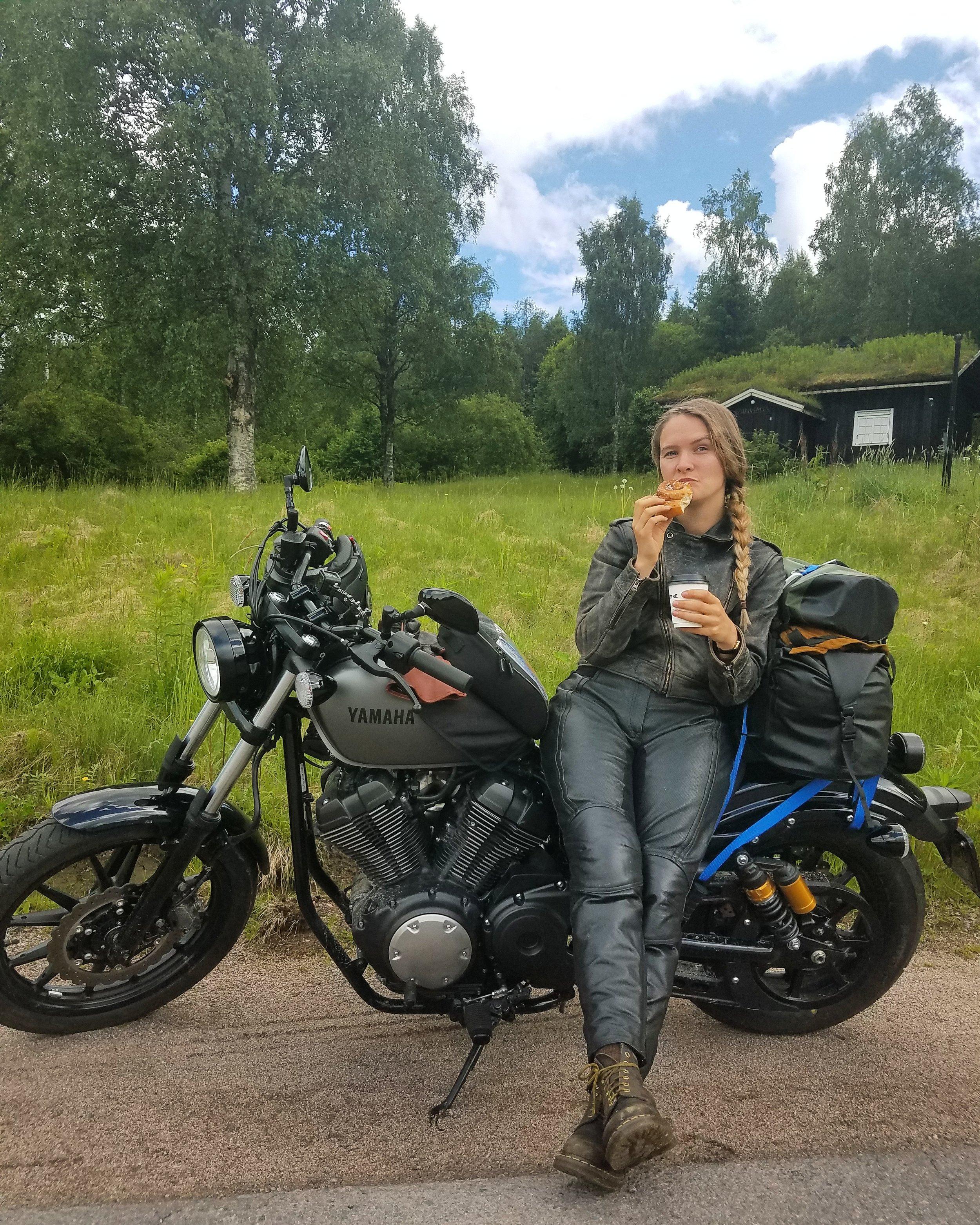 Enjoying a roadside fika near a grass roofed  stuga.