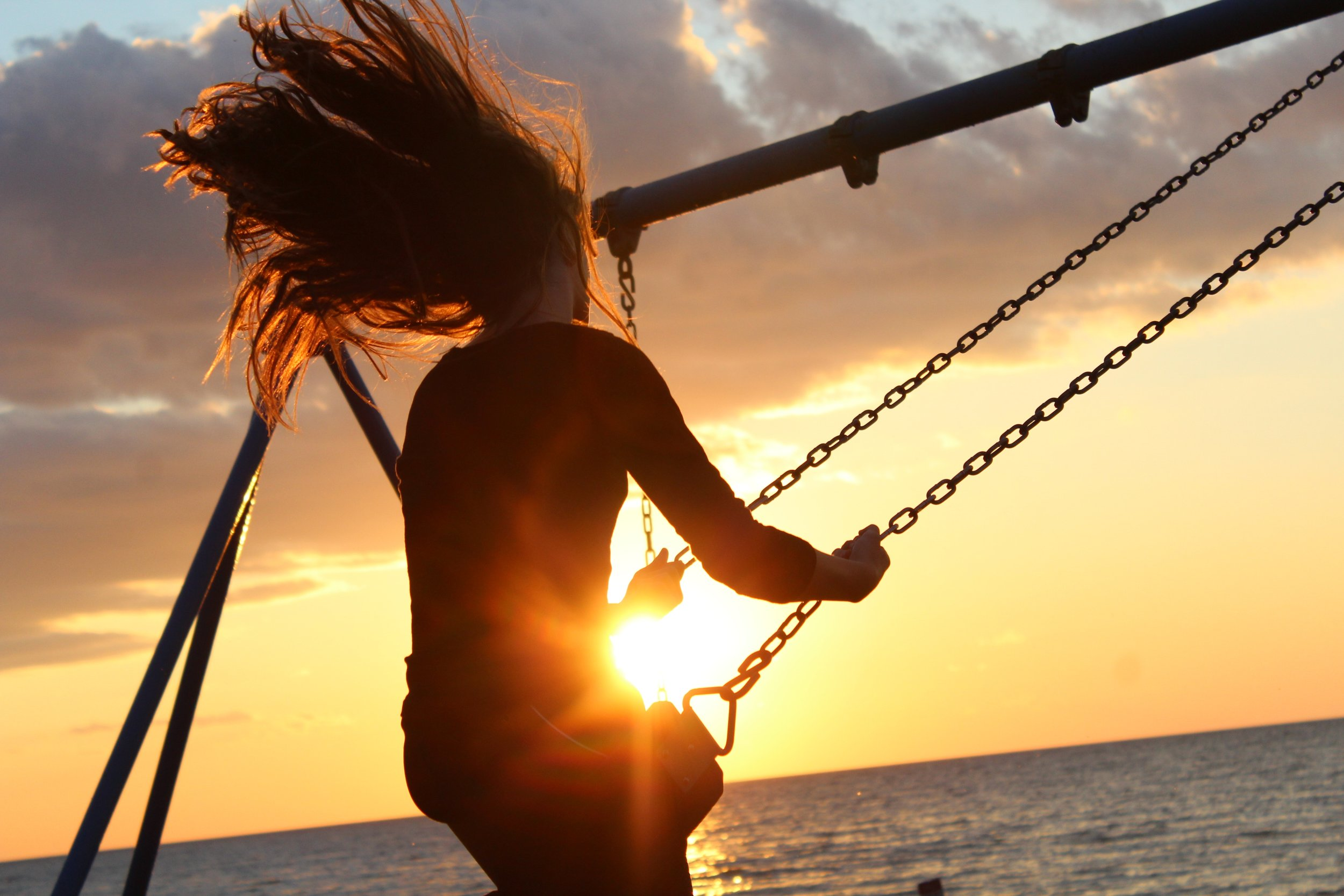 Happy swinging on the beach in West LA