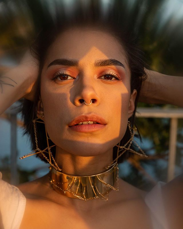 Love this shadow of an arrow that @paytot & I casted on @beck.preciado's face using paper we cut out ⬆️ I've been repeating the arrow symbol within my jewelry lately so how fitting is this to incorporate it into photography. Gorgeous makeup done by @ivettejoann29 | Photo shot by @paytot. This photo shakes me to my core❣️