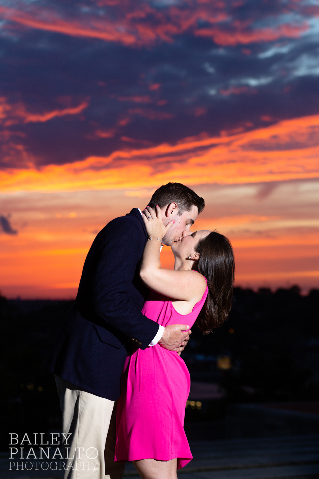 Bright Pink & Navy Colorful Sunset and Skyline Engagement Session Inspiration at the WWI Memorial | Kansas City, MO