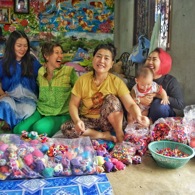 A rainbow of laughter with Jeap, Gina, Joy, Grandma and baby playing with pom-pom colors for the summer collection!