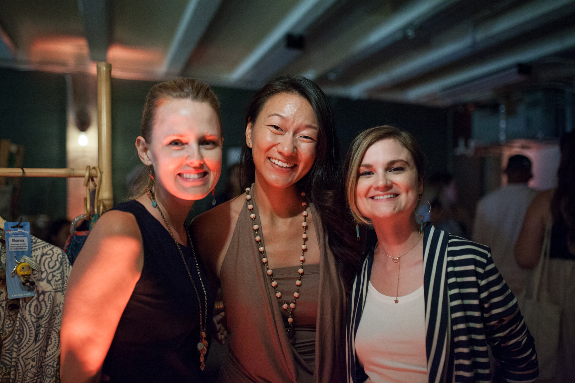 Heather young, elisha chan, and jennifer Klotz at the fair trade fashion show.  Photo:  CECILY BREEDING
