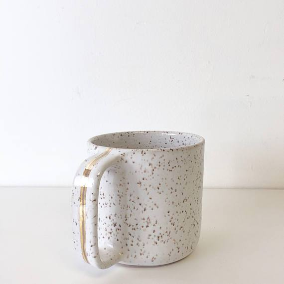 Coffee just might taste a little sweeter in this handmade mug.
