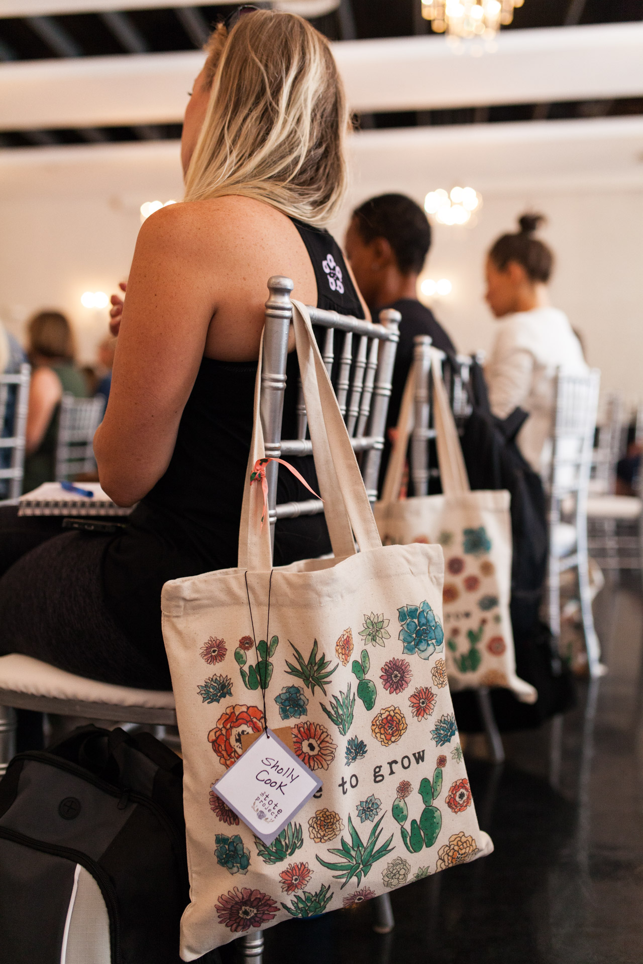 """The women all received a custom """"Free to Grow"""" swag bag from  The Tote Project , a women-owned company that fights sex trafficking through the sale of its products. You should check them out! PHOTO: @ERICAMCNICOLPHOTOGRAPHY"""