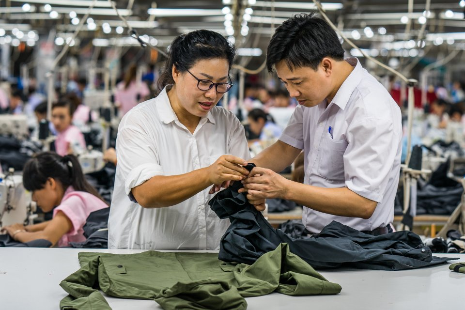 Workers in Bac Giang, Vietnam inspecting a garment for Everlane.