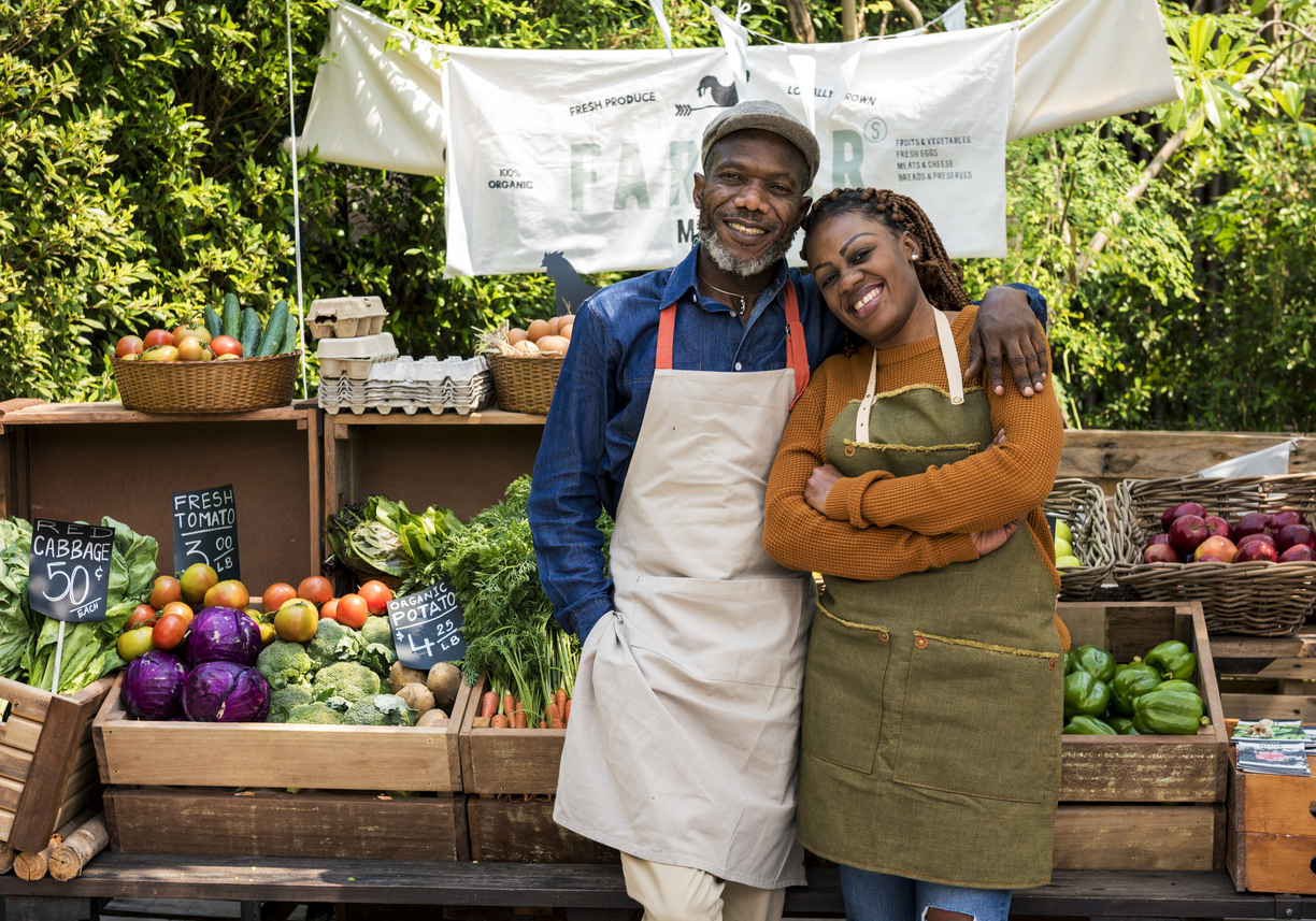 african american farmers at produce stand
