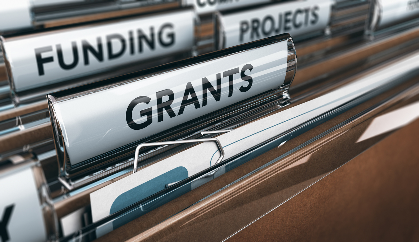 """file folders with """"funding"""" and """"grants"""" dividers"""