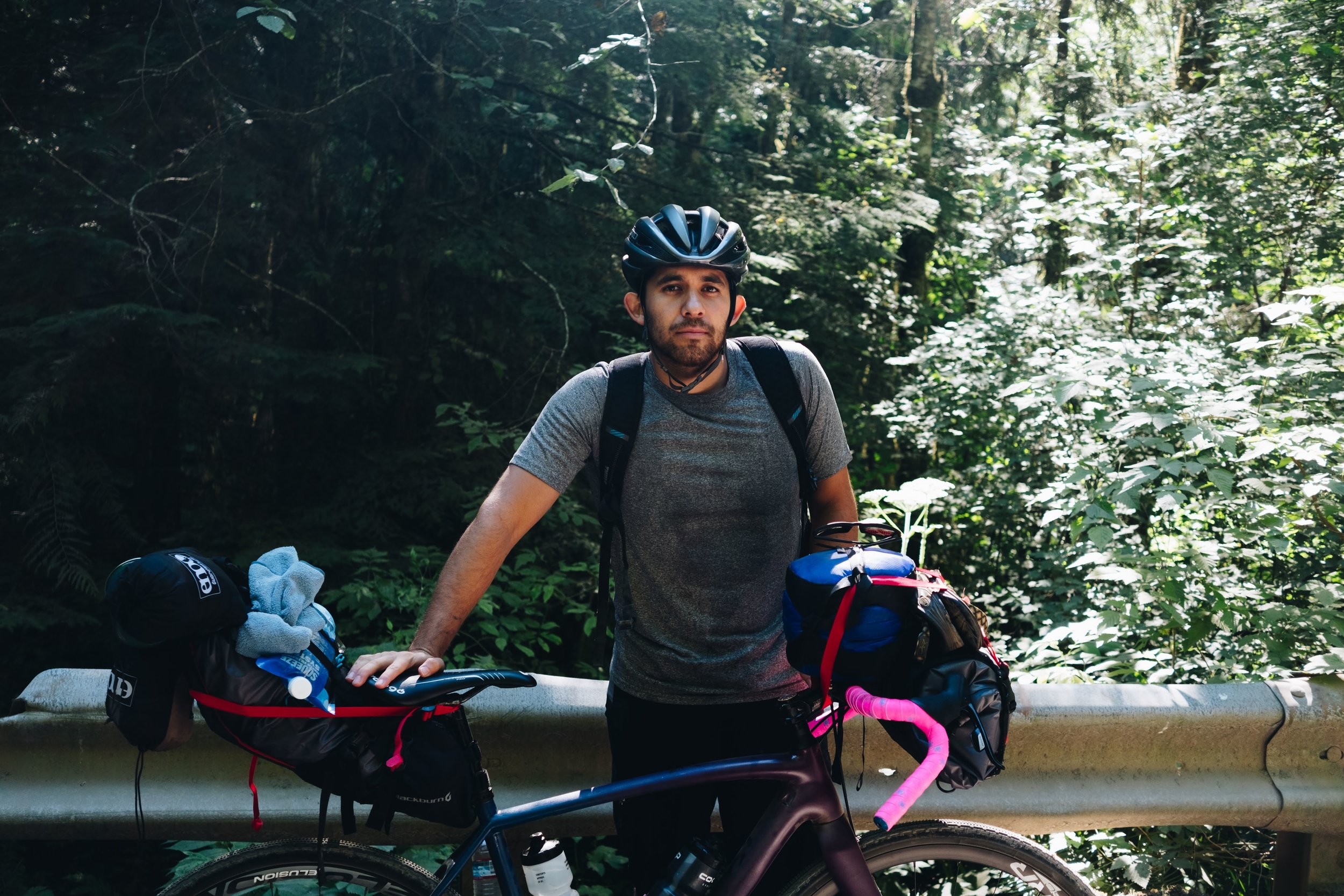 - Esteban went with a more cost efficient build just taking his old Specialized Crux putting 40mm tires, lots of straps, carabiners and a backpack.