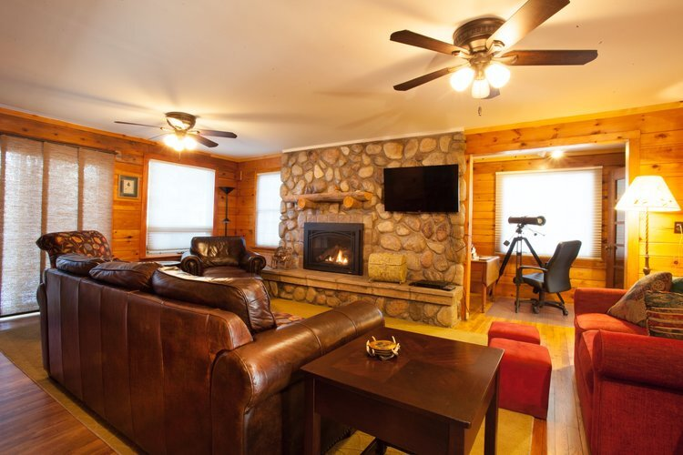 Au Sable Riverview resort The Lodge Living Room and fireplace Grayling Michigan.jpg
