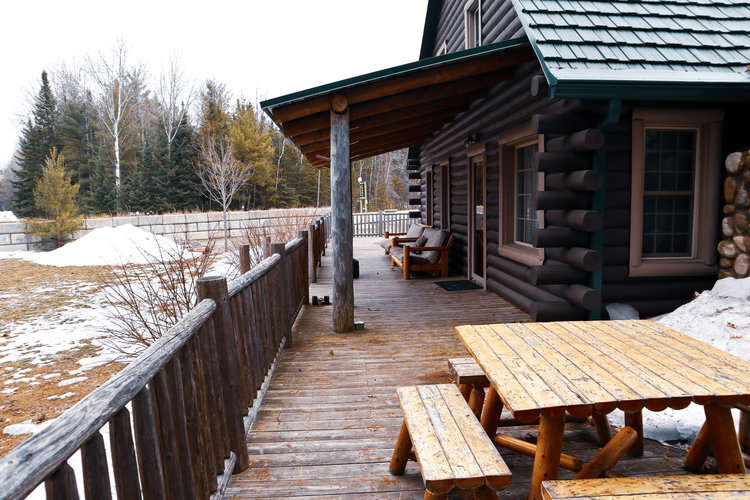 Au Sable Riverview resort The Lodge Porch area 3 with picnic table Grayling Michigan.jpg