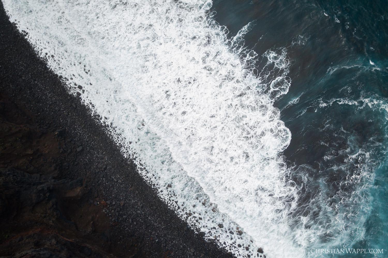 Waves crashing against a stone beach
