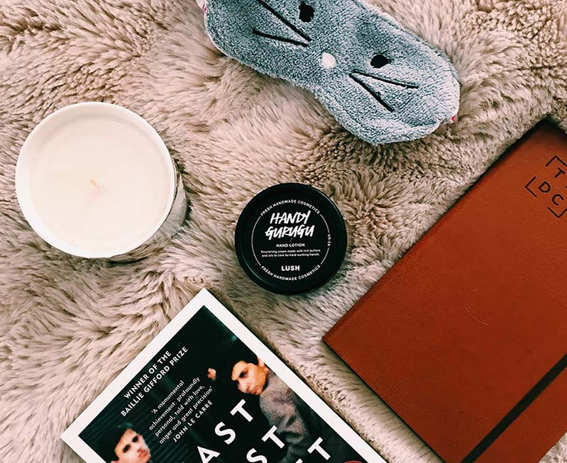 fxood-diary-on-fluffy-blanket-with-book-and-candle.jpg
