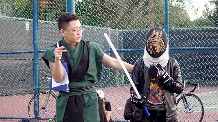 Daniel Kim helps a newcomer.
