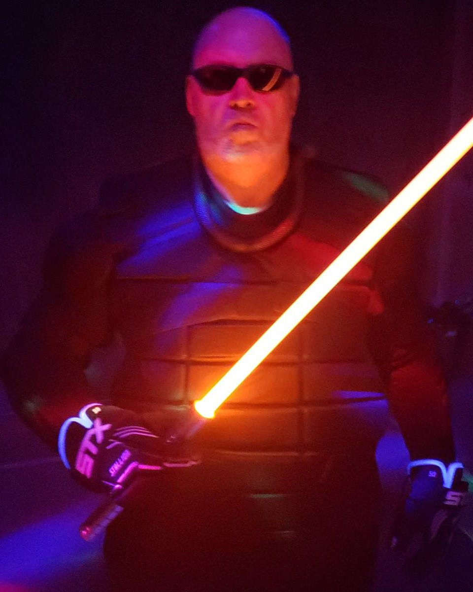 MIKE MOSKALSKI— ASST COACH   Mike's skills and experience serve as the perfect complement to Cody's, having trained in kempo, baton, and most relevantly, knife fighting, a close martial cousin to Lightspeed-saber fencing.