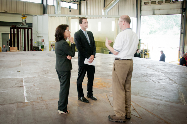 Congressman Himes and Bonnie Del Conte, President/CEO of CONNSTEP, speak with Macton President Peter McGonagle, while atop a rotating turntable for a large military operation.
