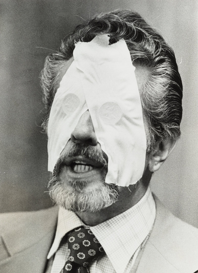 Dr. R. L. Noran, an ESP practitioner, with half-dollar coins taped over his eyes to prohibit the use of his visual sense during an ESP demonstration, ca. 1978. Courtesy of the artist's archive.