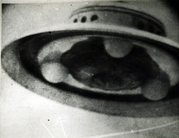 Photograph of an unidentified flying object taken in 1952 by George Adamski, a prolific American photographer of UFOs. Adamski claimed to have several encounters with aliens beginning in the late '40s, and even stated that he had been taken aboard alien spacecrafts and traveled to different planets. His claims drew the attention of several skeptics, and after a series of investigations, his photographs were eventually discredited. Courtesy of the artist's archive.