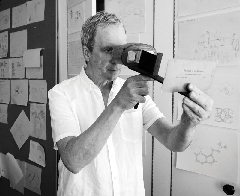 Tony Oursler in his New York apartment, holding an antique stereoscope viewer from the mid-1800's.
