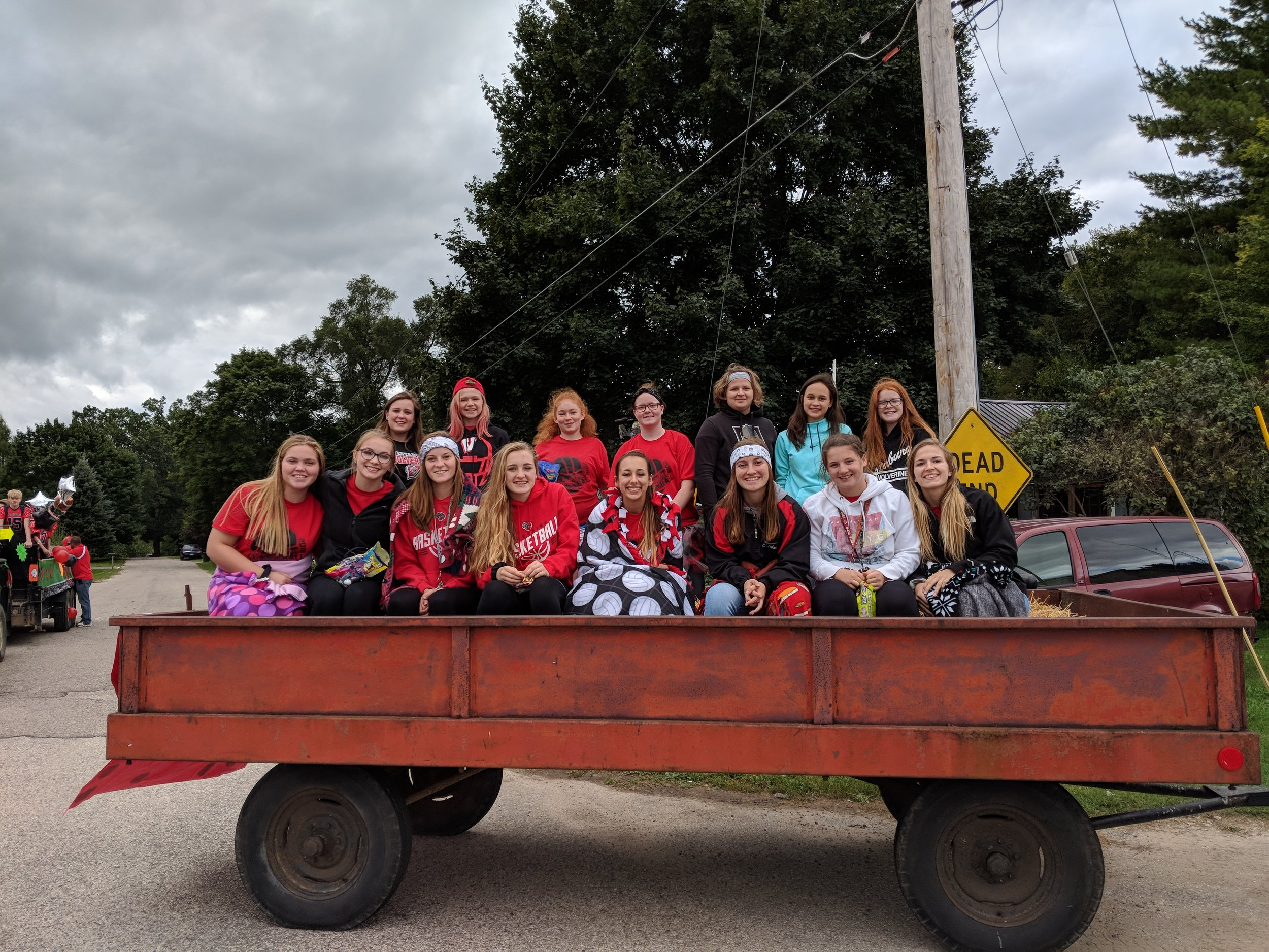 JV and Varsity Volleyball on Homecoming Float