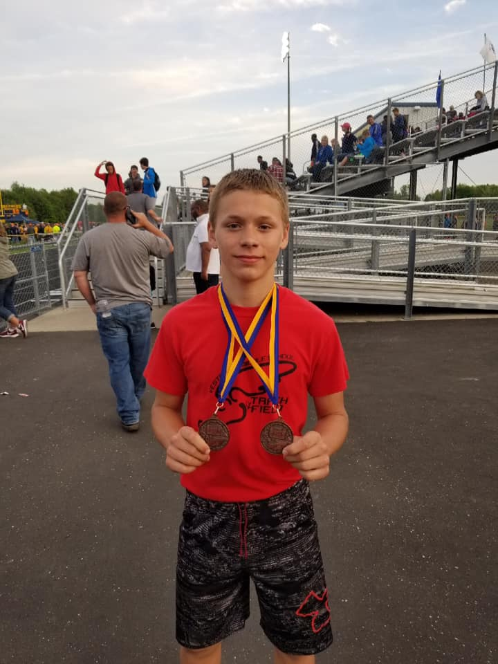 Wyatt Leeuw set new records in the 200M Hurdles and 400M, while earning 2 medals.