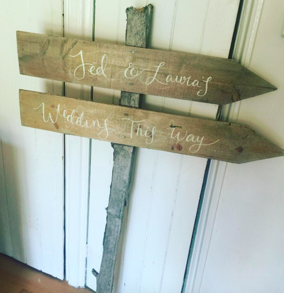 Wooden arrow sign £20 to hire