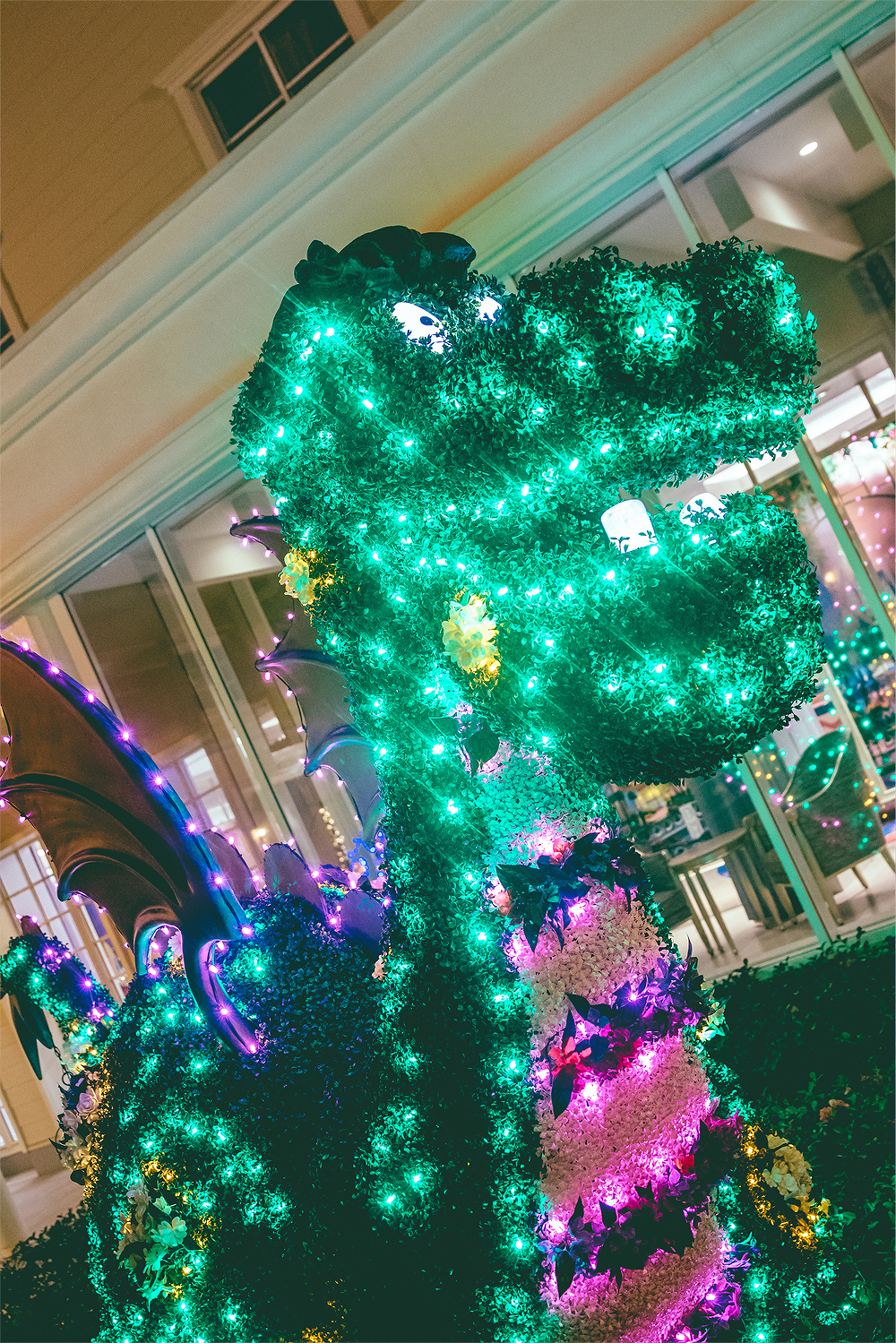 The Wish courtyard featured topiary floats from Dreamlights!