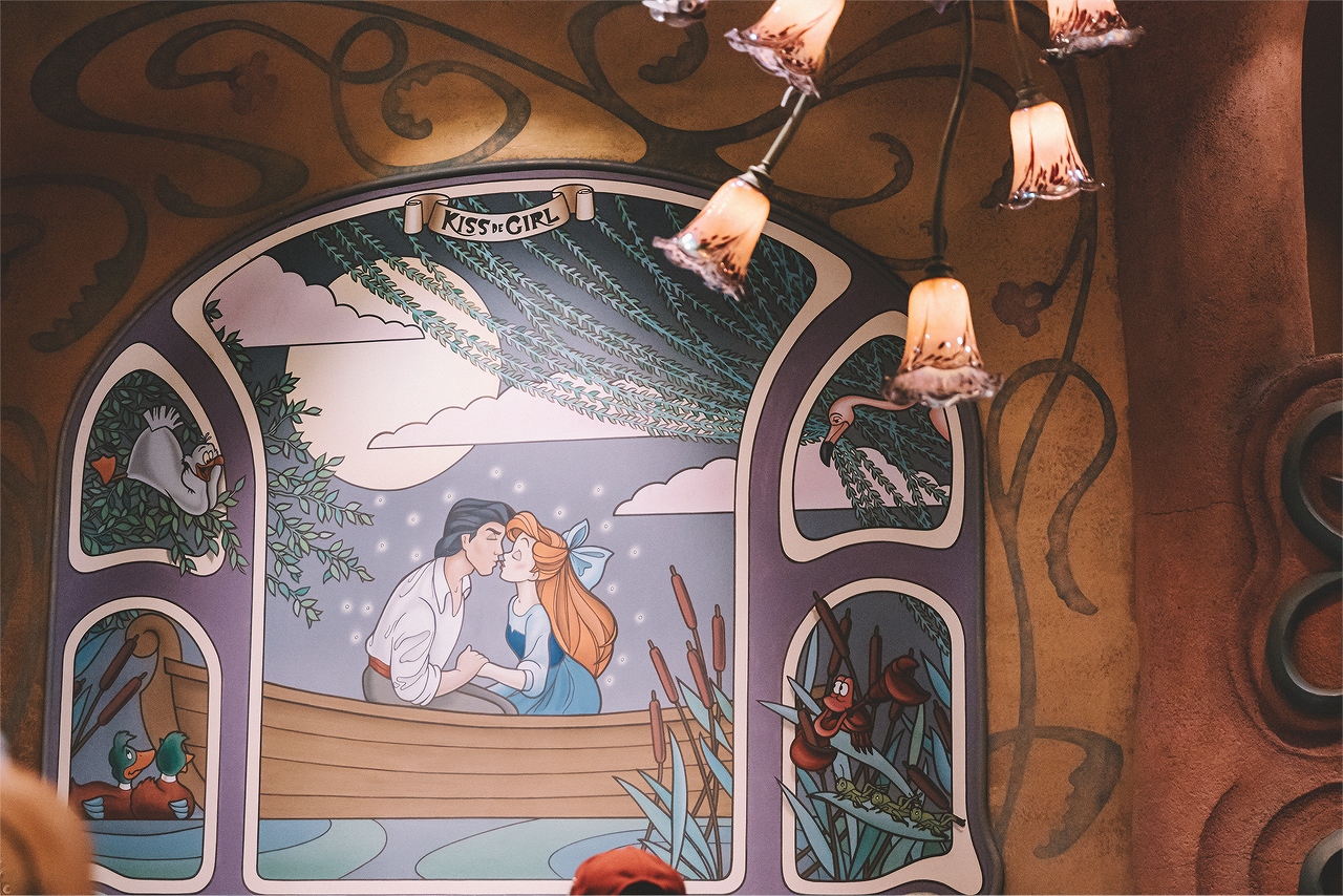 There are 3 different shops within Mermaid Lagoon, including The Sleepy Whale (the store's entrance is the Whale's mouth!), Mermaid Treasures, and Kiss De Girl Fashions (featuring an art nouveau theme).